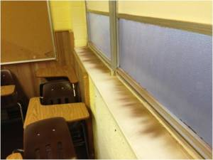 The current windows at LIS are not energy efficient and they do not protect against cold or dust. After a recent dust storm, the sills were covered with dust.