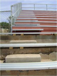 Concrete is deteriorating and step heights are mismatched, a tripping hazard and a Life Safety Code violation.