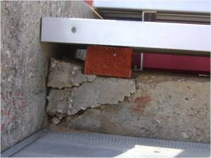 Deteriorating concrete requires shims to support bleachers