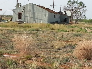 Abandoned Oxy Permian Building on 1585 northwest of Sundown, Roof blown off in storm.  Metal was seen wrapped in fences in the area.