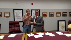 F E Shaheen presents name plate and keys to the office to New Superintendent Jeff Northern
