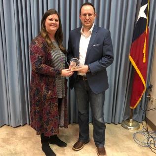 Missy Passmore presents the Main Street Hero award to Tanner Terrell